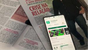 Telemóvel, com a app do Press Reader ligada, em cima de duas revistas cor-de-rosa.